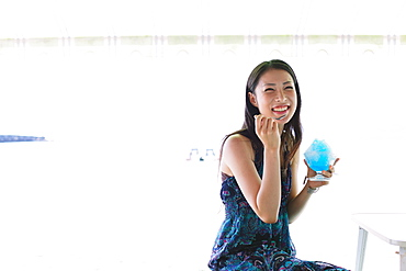 Portrait of a Japanese woman eating shaved ice