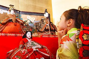 Young Japanese Girl with Traditional Hina Ningyo (Dolls)