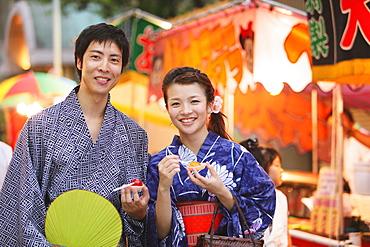 Young Japanese Couple Wearing Yukata at Summer Festival