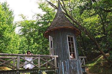 Children Playing in Wooden House