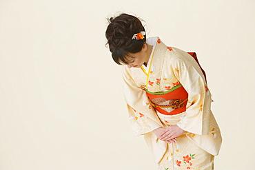 Woman Wearing Kimono Bowing