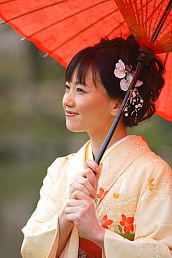 Japanese Woman Holding Parasol
