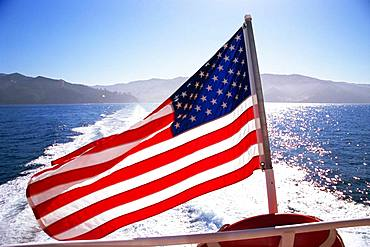 American Flag on back of boat, California, U.S.A.