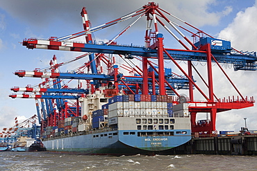 Containers being loaded on ship with cranes, Bremerhaven, Bremen, Germany