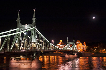 Budapest illuminated in the evening - Liberty Bridge over the Danube leading to the Gellert Hotel, Hungary