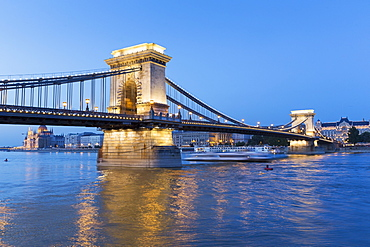 A view from the Pest Bank of the 380 metre long Chain Bridge at dusk, Budapest, Hungary
