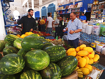 A fruit stand in a market hall in Larache, Morocco