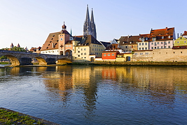 View of Cathedrals and Stone Bridge over Danube river in Regensburg, Germany