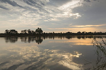 A view from the Ndhovu Safari Lodge reflected in the Okavango, Caprivi, Namibia