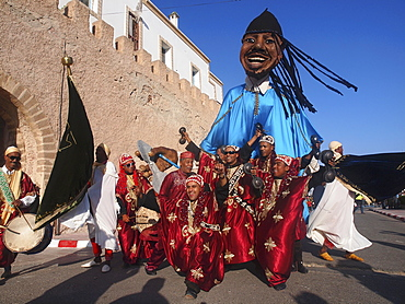 The grand opening parade of the Gnaoua Festival in Essaouira, Morocco, is like a big carnival with figures many metres high