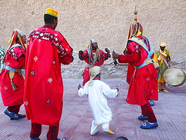 Brightly dressed Gnaoua musicians during the Gnaoua Festival (third weekend in June) Essaouira, Morocco
