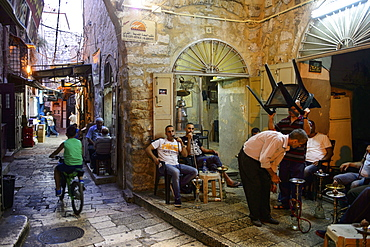 The Muslim quarter in the old town of Jerusalem, men with water pipes, Israel