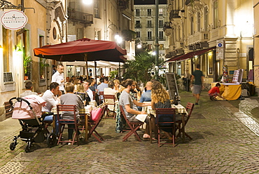 People in the street cafe 'Casa Martin' in Sant Agostino street, Turin, Italy