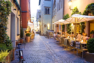 People sitting in outdoors cafe, Regensburg, Bavaria, Germany