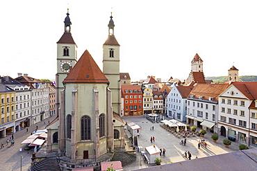 View of Neupfarrkirche, Golden Tower and Town Hall in Neupfarrplatz, Regensburg, Germany