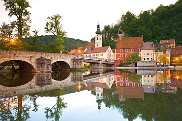 View of bridge, Naab river and medieval village of Kallmunz, Bavaria, Germany