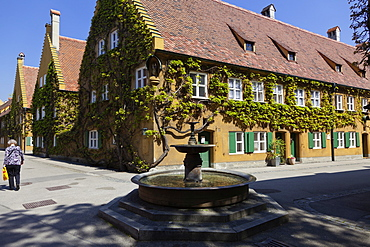 View of Fuggerei social housing complex at Augsburg, Bavaria, Germany