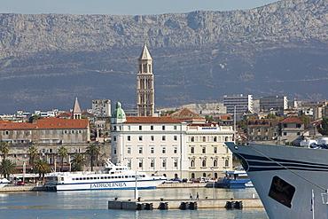 View of old town and ferry in Adriatic sea, Dalmatia, Croatia