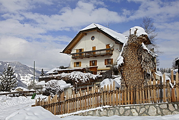 View of Restaurant Bear Cave surrounded with snow in winter, South Tyrol, Italy