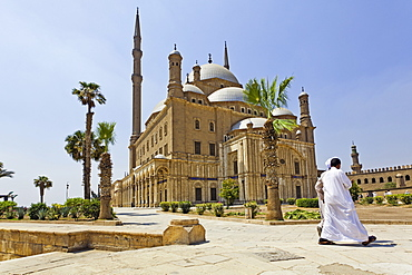 Man walking outside mosque of Muhammad Ali in Citadel, Cairo, Egypt