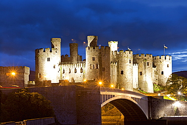 View of illuminated Conwy castle and river Conwy at Wales, UK