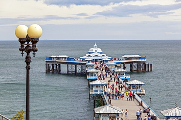 People at Victorian pier at Colwyn Bay, Wales, UK