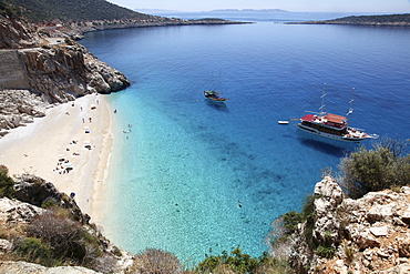 People and two ships at Kaputas beach in Turkey