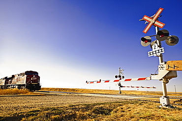 Railway crossing line at Highway 1 west to Alberta, Saskatchewan, Canada