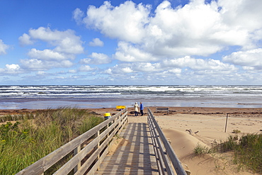 Wooden bridge on beach of Brackley-Dalvay, Prince Edward island National park, Canada