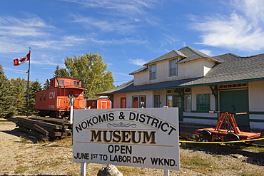 Signboard of Museum in Nokomis with old trains and house, Saskatchewan, Canada