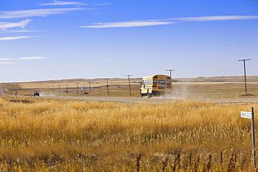 View of school bus on highway 4 North, Saskatchewan, Canada