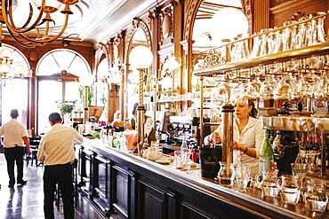 Bar counter with bar tender in Cafe de la Paix, La Rochelle, Ile de Re, France