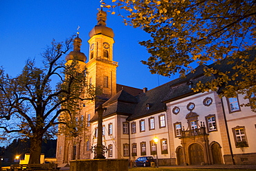 View of abbey church of St Peter at night, Freiburg, Germany