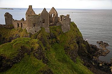 View of Dunluce Castle and Atlantic Ocean in Ireland, UK