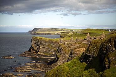 View of Dunluce Castle on cliffs and Atlantic Ocean in Ireland, UK