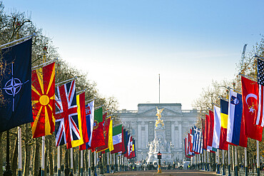 View of Buckingham Palace and The Mall lined with flags, London, England, United Kingdom, Europe