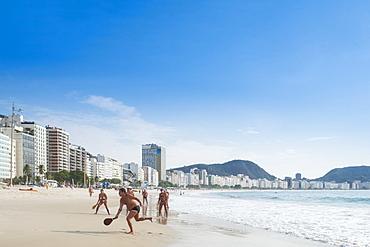Locals playing frescobol (Matkot) in the morning on Copacabana Beach, Rio de Janeiro, Brazil, South America