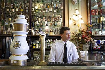 A bar man in a traditional boteco bar in central Rio de Janeiro, Brazil, South America
