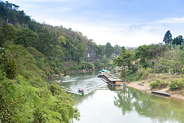 A boat on the River Kwai with the POW-built Wampoo Viaduct behind, Death Railway near Nam Tok, Kanchanaburi, Thailand, Southeast Asia, Asia