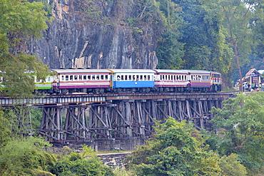 River Kwai train crossing the Wampoo Viaduct on the Death Railway above the River Kwai valley near Nam Tok, Kanchanaburi, Thailand, Southeast Asia, Asia