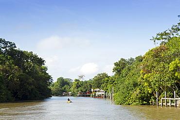 A boat on an igarape (flooded creek) in the Brazilian Amazon near Belem, Para, Brazil, South America