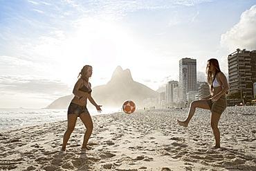 Women playing altinha (football) on Ipanema beach, Rio de Janeiro, Brazil, South America