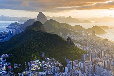 View of the Sugar Loaf, Sao Joao favela, Guanabara bay, the Atlantic and the mountains of Rio and Niteroi, Rio de Janeiro, Brazil, South America