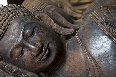 Carved Buddha heads, Phnom Penh, Cambodia, Southeast Asia