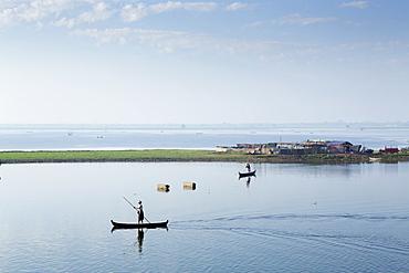Duck farmers herding ducks on Taungthaman Lake near Amarapura, Mandalay, Myanmar (Burma), Southeast Asia