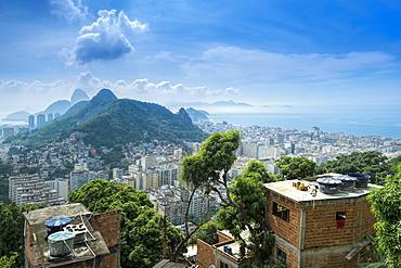 Rio de Janeiro from Cabritos favela in Copacabana, Moro Sao Joao and Sugar Loaf in the foreground, Copacabana right of frame, Rio de Janeiro, Brazil, South America