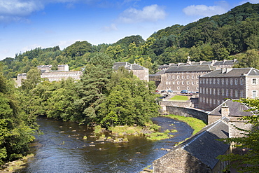 View of the town of New Lanark, UNESCO World Heritage Site, and the Clyde River, Lanarkshire, Scotland, United Kingdom, Euope
