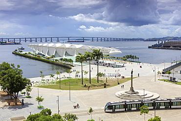 The Museum of Tomorrow, architect Santiago Calatrava, Porto Maravilha area and Niteroi Bridge with the VLT tram in the foreground, Rio city centre, Rio de Janeiro, Brazil, South America