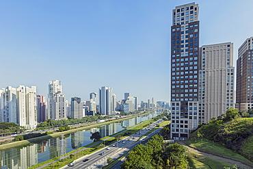 Traffic on Marginal Pinheiros urban highway, the Pinheiros Rriver and skyline of new business centre on Rua Berrini in Brooklin, Sao Paulo, Brazil, South America