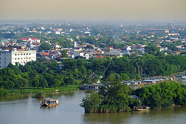 A view of the Perfume River and skyline of the city of Hue, Vietnam, Indochina, Southeast Asia, Asia
